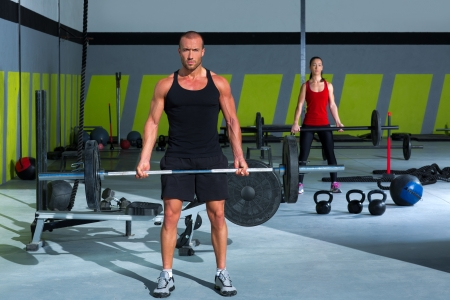 gym man and woman with weight lifting bar workout in crossfit exercise Stock Photo - 17050598
