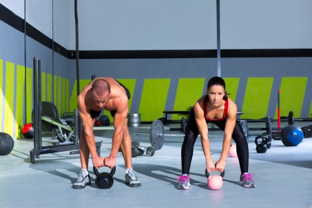 Kettlebells swing crossfit exercise man and woman workout at gym Stock Photo - 17050600