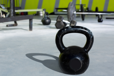 Kettlebell at crossfit gym with lifting bars in background photo