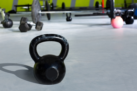 cross bar: Kettlebell at crossfit gym with lifting bars in background