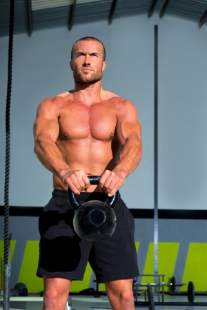 Crossfit Kettlebells swing exercise man workout at fitness gym Stock Photo - 17050607