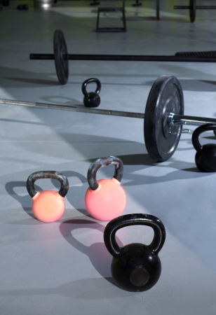 Kettlebells at crossfit gym with lifting bars in background Stock Photo - 17058083