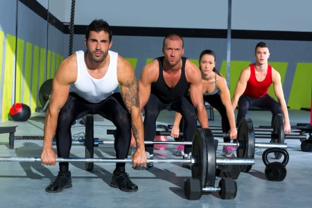 gym group with weight lifting bar workout in crossfit exercise photo