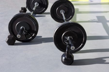 Kettlebells at crossfit gym with lifting bar weights fitness equipment photo
