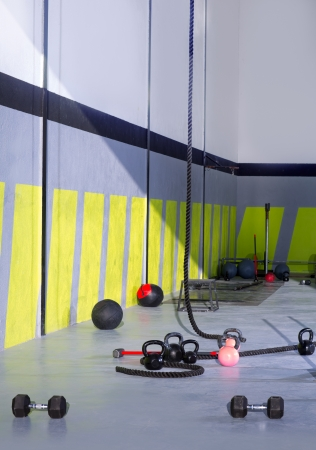 pulling rope: Crossfit Kettlebells ropes and hammer gym with lifting bars and wall balls