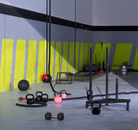Crossfit Kettlebells ropes and hammer gym with lifting bars and wall balls photo