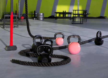 Crossfit Kettlebells ropes and hammer gym with lifting bars and wall balls