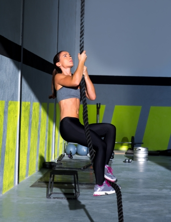 Crossfit rope climb exercise in fitness gym workout Stock Photo - 17050627