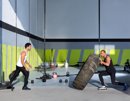 crossfit: Crossfit flip tires men flipping each other the wheel workout