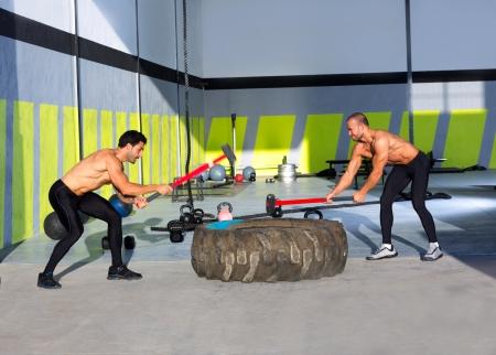 sledge: Crossfit sledge hammer men workout at gym