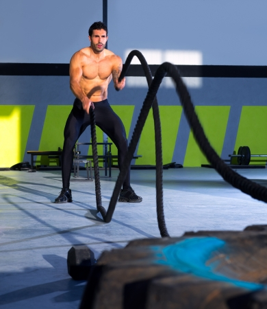 Crossfit battling ropes at gym workout from big tires Stock Photo - 17050623