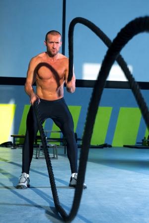 battling: Crossfit battling ropes at gym workout fitness exercise