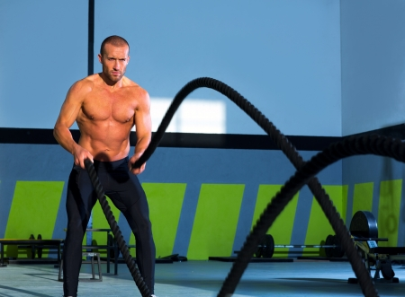 crossfit: Crossfit battling ropes at gym workout fitness exercise
