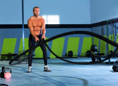 Crossfit battling ropes at gym workout fitness exercise photo