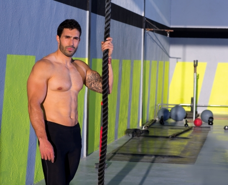 Crossfit handsome man with climbing rope relaxed at gym Stock Photo - 17050613