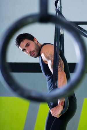Crossfit dip ring man workout at gym dipping exercise photo
