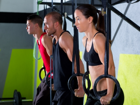 Crossfit dip ring group workout at gym dipping in a row exercise Stock Photo - 17050625