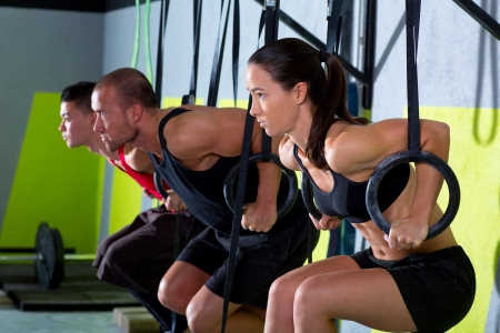 Crossfit dip ring group workout at gym dipping in a row exercise
