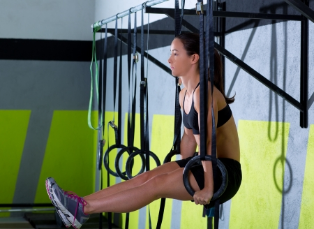 Crossfit dip ring woman workout at gym dipping exercise photo