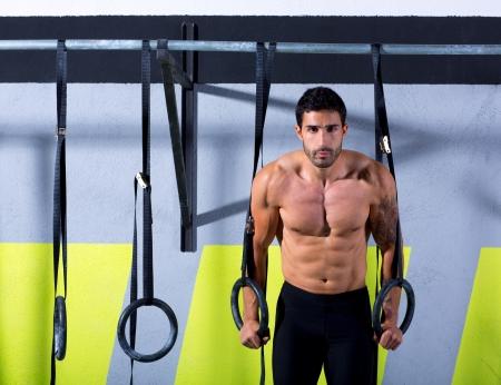 Crossfit dip ring man workout at gym dipping exercise Stock Photo