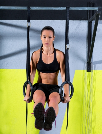 Crossfit dip ring woman workout at gym dipping exercise Stock Photo - 17050554