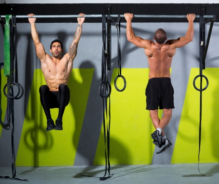 cross bar: Crossfit toes to bar men pull-ups 2 bars workout exercise at gym