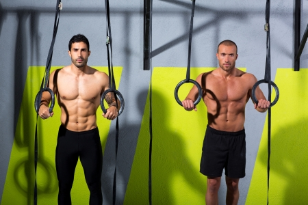 Crossfit dip ring two men workout at gym dipping exercise Stock Photo - 17050524
