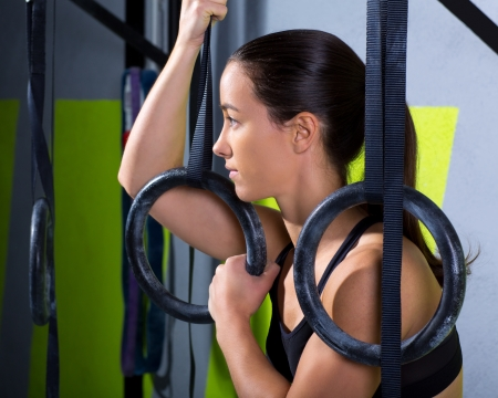 Crossfit dip ring woman relaxed after workout at gym dipping exercise Stock Photo - 17050599