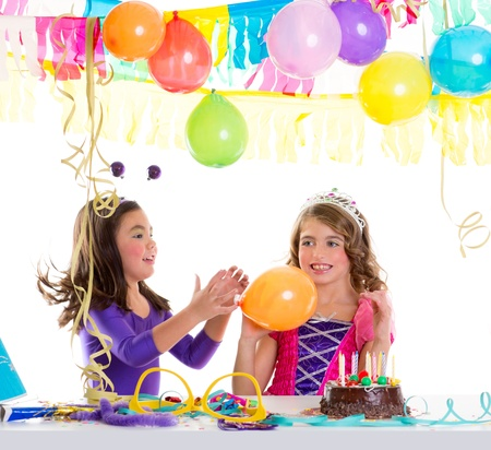 children happy birthday party girls with balloons and chocolate cake photo