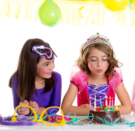 children happy girls blowing birthday party chocolate cake candles Stock Photo - 17237618