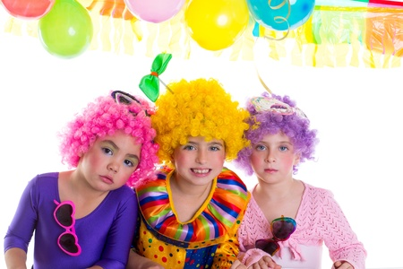 kids dress: Children happy birthday party with clown wigs colorful holiday celebration Stock Photo