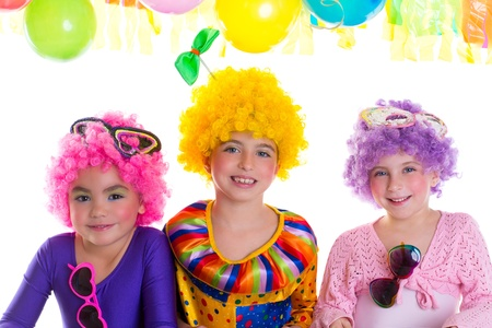 Children happy birthday party with clown wigs colorful holiday celebration photo