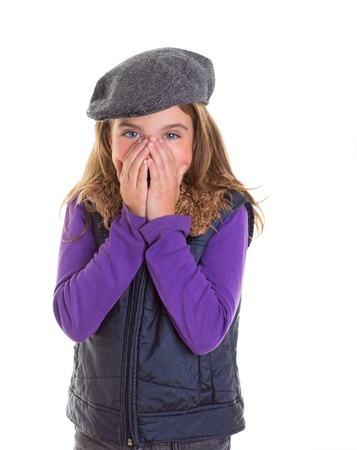 little girl surprised: Child kid shy girl smiling hiding her face with hands with winter cap fashion Stock Photo