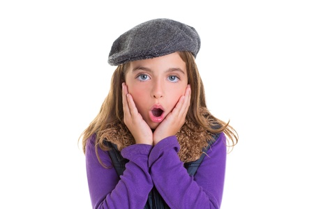 Child kid girl face expression of surprise hands in face on white with winter fashion cap photo