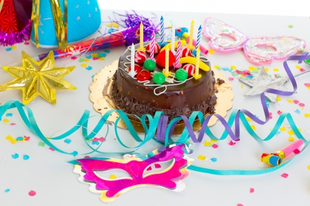 surprise party: Children birthday party with chocolate cake confetti garland and serpentine