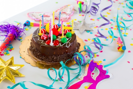 birthday cakes: Children birthday party with chocolate cake confetti garland and serpentine