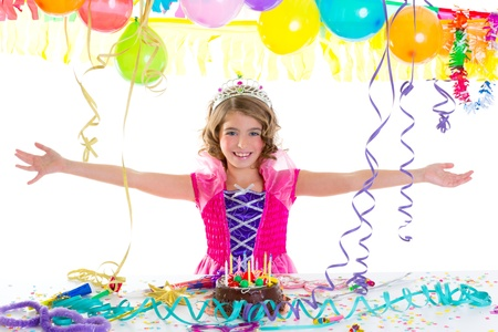 child kid crown princess in birthday party happy gesture and chocolate cake photo