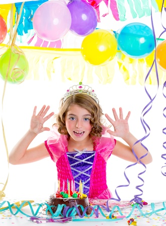fancy dress party: child kid crown princess in birthday party happy gesture and chocolate cake Stock Photo