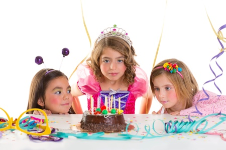 children kid girls birthday party looking excited chocolate candles cake photo