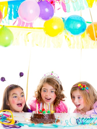 kids dress: children kid girls birthday party looking excited chocolate candles cake