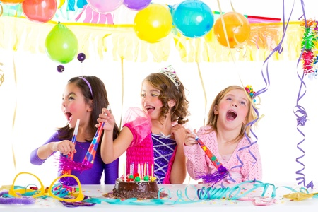 children kid in birthday party dancing happy laughing with baloons serpentine and garlands
