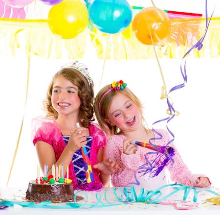 fancy dress: children kid in birthday party dancing happy laughing with balloons serpentine and garlands Stock Photo
