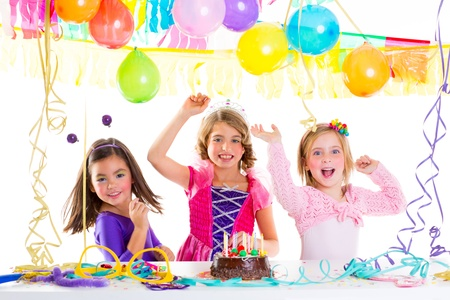 children kid in birthday party dancing happy laughing with baloons serpentine and garlands photo