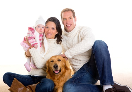 animal family: Baby girl mother and father family happy in winter with golden retriever dog