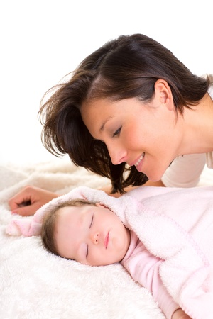 Baby girl sleeping with mother care near on white fur Stock Photo - 17237595