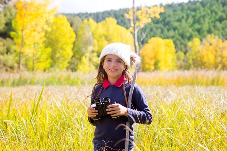 Explorer binocular kid girl in yellow autumn nature outdoor photo