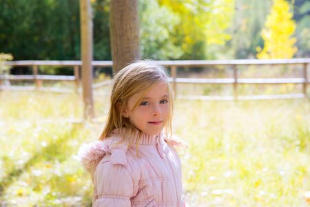 Child girl in autumn outdoor nature landscape in Spain photo