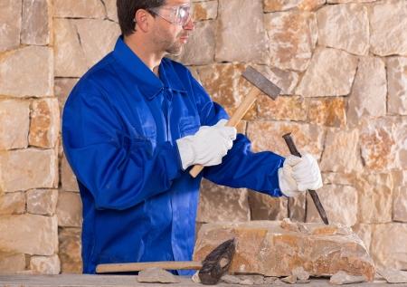 Masonry mason stonecutter man with hammer working on stone wall construction Stock Photo - 17600596