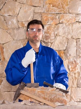Masonry mason stonecutter man with hammer working on stone wall construction Stock Photo - 17600627