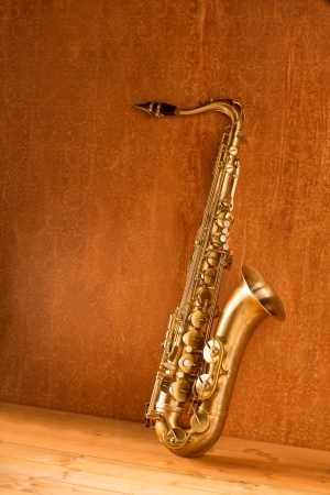 Sax golden tenor saxophone in vintage retro background photo